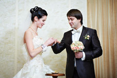 Happy bride wears wedding ring her groom Stock Photo