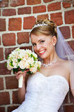 Happy bride with wedding bouquet Stock Image