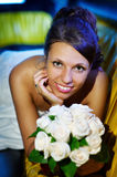 Happy bride with wedding bouquet Stock Photos