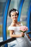 Happy bride with a wedding bouquet Stock Photos