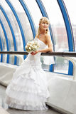 Happy bride with wedding bouquet on bridge Stock Images