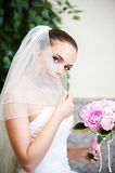 Happy bride with wedding bouquet Royalty Free Stock Photo