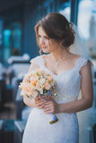 Happy bride with a wedding bouquet Stock Photography