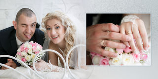 Happy bride with a wedding bouquet from roses and the cheerful groom who is putting out the tongue, lie on a bed in bedroom Stock Images