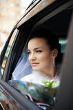 Happy bride in a wedding car Royalty Free Stock Photos