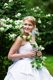 Happy bride in wedding dress and flowers Royalty Free Stock Photo