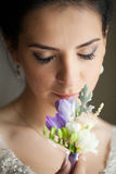 Happy bride in wedding dress with flowers Royalty Free Stock Photography