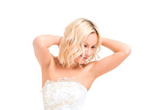 Happy bride in a wedding dress posing. On a white background Stock Image