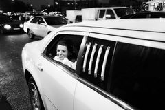 Happy bride in wedding limo Stock Photo