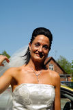 Happy bride in white dress. A happy bride in a white dress Royalty Free Stock Image