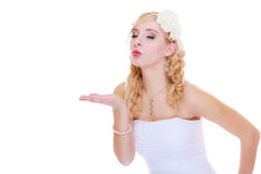 Happy bride in white dress sending air kiss Stock Images