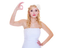 Happy bride in white dress showing a ok sign Stock Photography