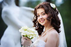Happy bride with white wedding bouquet Stock Photos