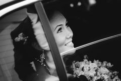 Happy bride in window a wedding limo Royalty Free Stock Photos
