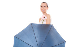 Happy bride woman holding umbrella and flower. Stock Photography