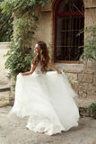Happy bride woman running in wedding dress at park Royalty Free Stock Image
