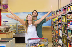 Happy bright couple buying food products Stock Photo