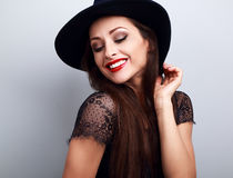 Happy bright makeup lady in fashion hat looking down with red li Royalty Free Stock Images