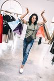 Happy bright woman in shop with bags stock photo