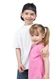 Happy brother and sister. Half body portrait of happy preschool brother and sister, isolated on white background Royalty Free Stock Images