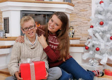 Happy brother and sister in christmas eve at home Royalty Free Stock Photography