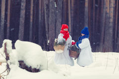 Happy brother and sister in costumes snowman walking in winter forest, Stock Image