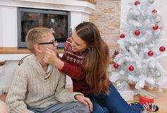 Happy brother and sister have fun near christmas tree Stock Photography