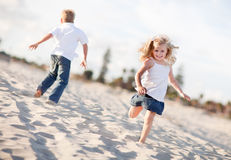 Happy Brother and Sister Having Fun at the Beach Royalty Free Stock Photography