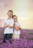Happy brother and sister in lavender summer field Stock Images