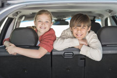 Happy Brother And Sister Leaning On Car Seat Stock Image
