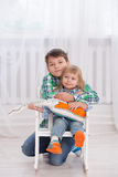 Happy brother and sister. Little brother hugs his sister in a bright interior Royalty Free Stock Photo