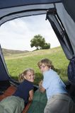 Happy Brother And Sister Lying In Tent Royalty Free Stock Photos