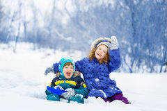 Happy brother and sister playing in the winter park. Royalty Free Stock Image