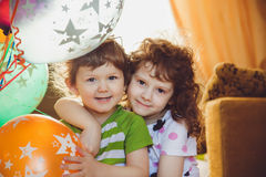 Happy brother and sister smiling. And embracing stock photography