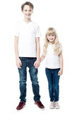 Happy brother and sister, studio shot Royalty Free Stock Images