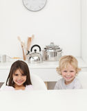 Happy brother and sister waiting their breakfast Stock Photography