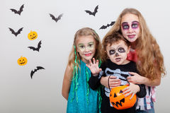 Happy brother and two sisters on Halloween party Stock Images