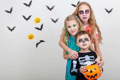 Happy brother and two sisters on Halloween party Stock Image
