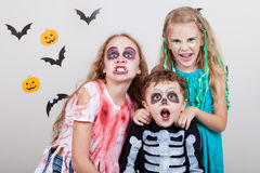 Happy brother and two sisters on Halloween party Royalty Free Stock Photography