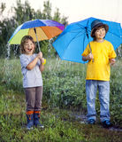 Happy brother with umbrella outdoors Royalty Free Stock Photos