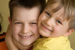 Happy Brothers. Close up portrait of two smiling, happy brothers Stock Photography