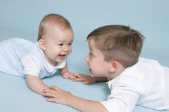 Happy Brothers. Brothers playing and holding hands Royalty Free Stock Photography