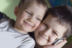 Happy brothers. Brothers colling to father stock photography