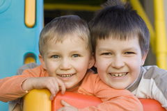 Happy brothers. Boys on a playground stock image