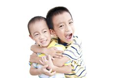 Happy brothers hold together. Very happy brothers embraced each other in the white background stock photography