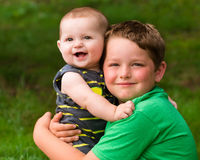 Happy brothers hugging in summer portrait. Outdoors royalty free stock photo