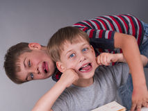 Happy brothers making funny expressions Stock Image