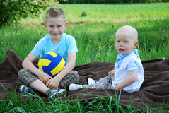 Happy brothers outdoors in summer Stock Photos