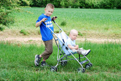 Happy brothers outdoors in summer Stock Images