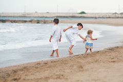 Happy Brothers playing on beach, Spain Stock Images